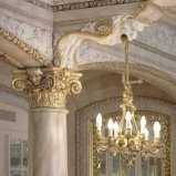 Detail of capital and chandelier in the Isabella Room. © J. Craig Sweat Photography. Used by permission.